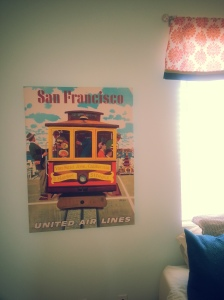 This trolly picture was hanging in the guest room at our condo, but I always knew I'd use it in our future baby's room. See the little red headed girl? I have a strange hunch that Daphne may have red hair! But if she doesn't, at least she'll learn to love one of my favorite cities - San Francisco!